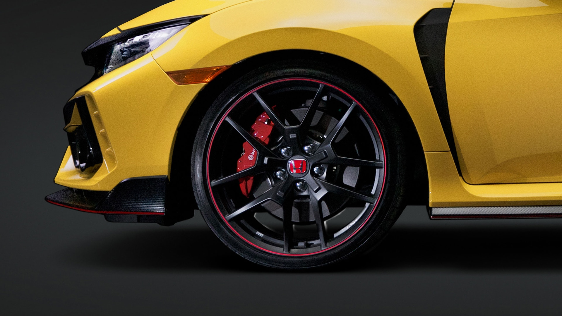 Detail of BBS forged-aluminum wheels on the 2021 Honda Civic Type R Limited Edition. Plays video. Opens a dialog.