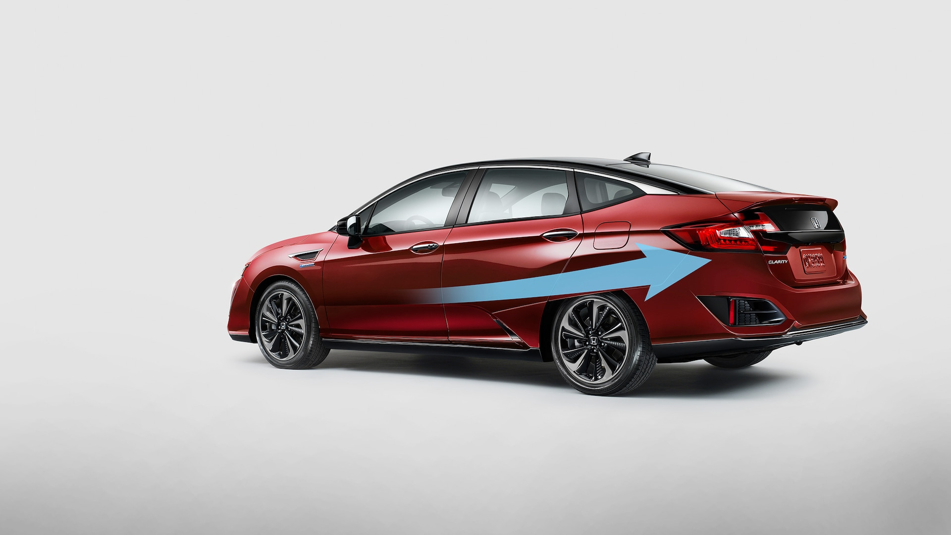Aerodynamic airflow illustration for rear view of 2021 Honda Clarity Fuel Cell in Crimson Pearl.