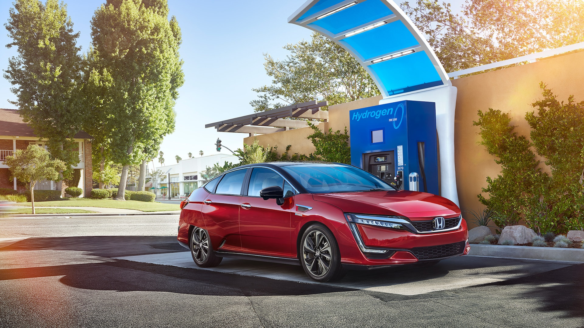 Front view of 2021 Honda Clarity Fuel Cell refueling at hydrogen fuel station.