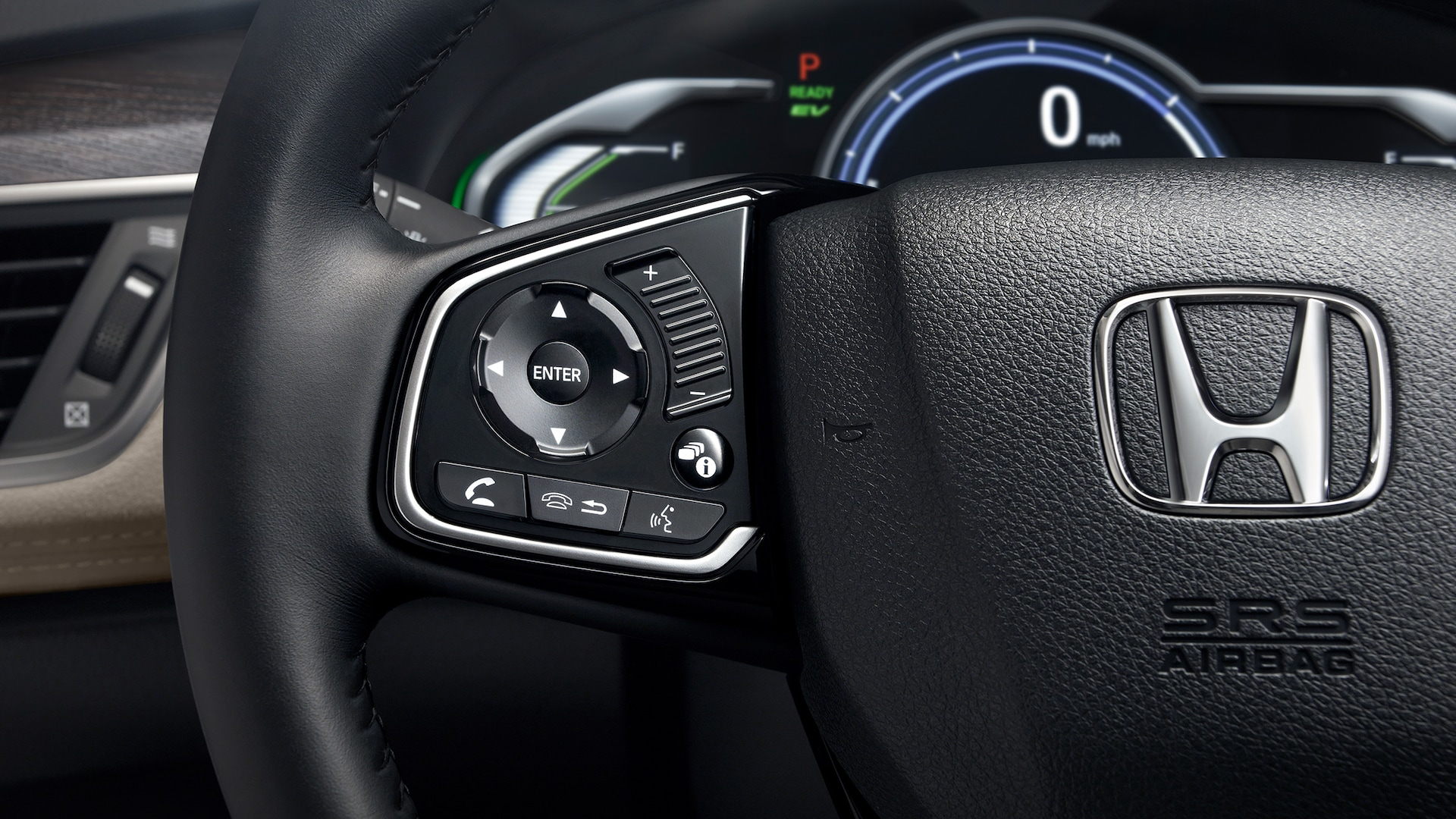 Detail of Bluetooth® steering wheel-mounted controls.