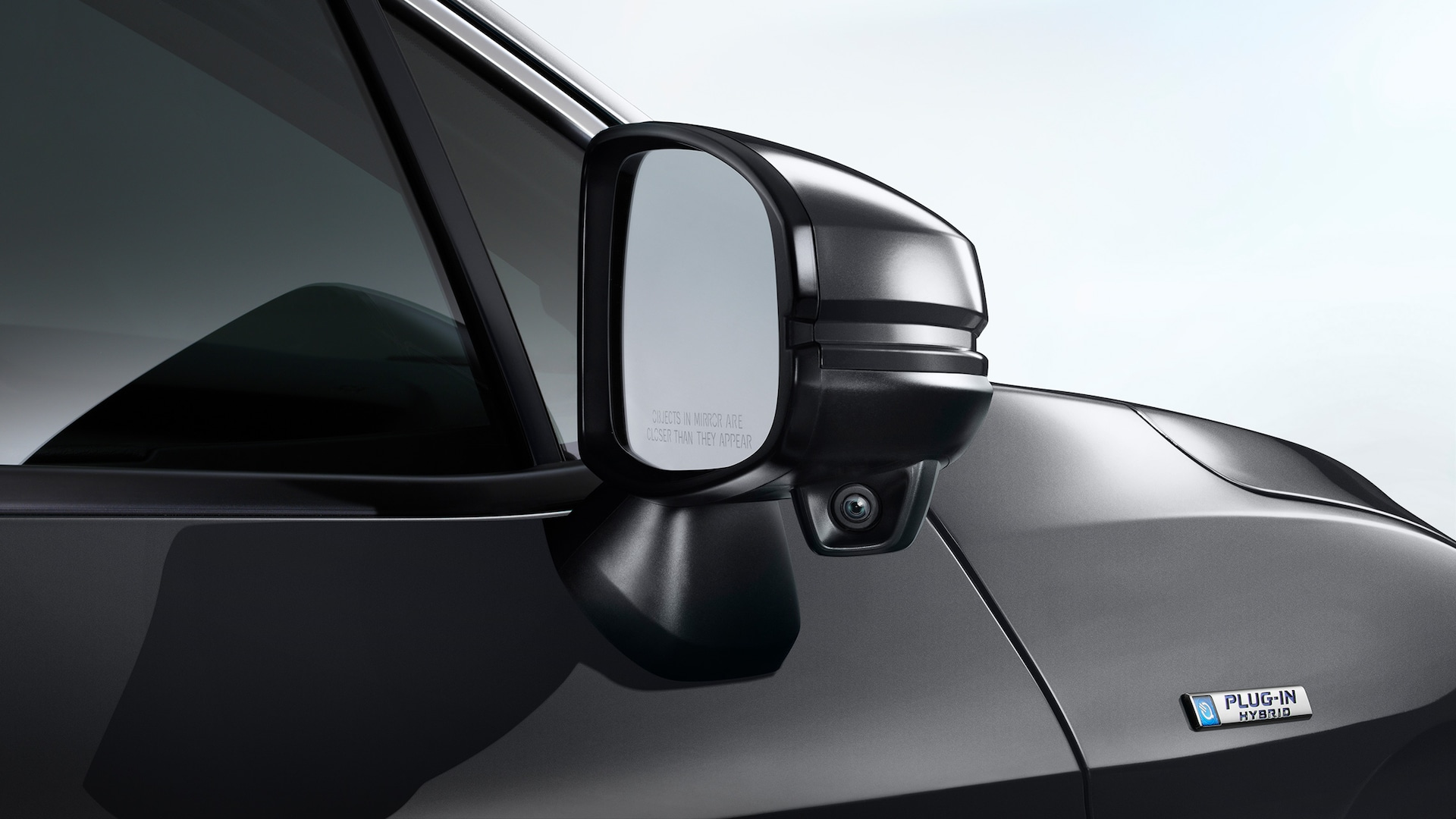 Detail of Honda LaneWatch™ camera on passenger-side mirror.