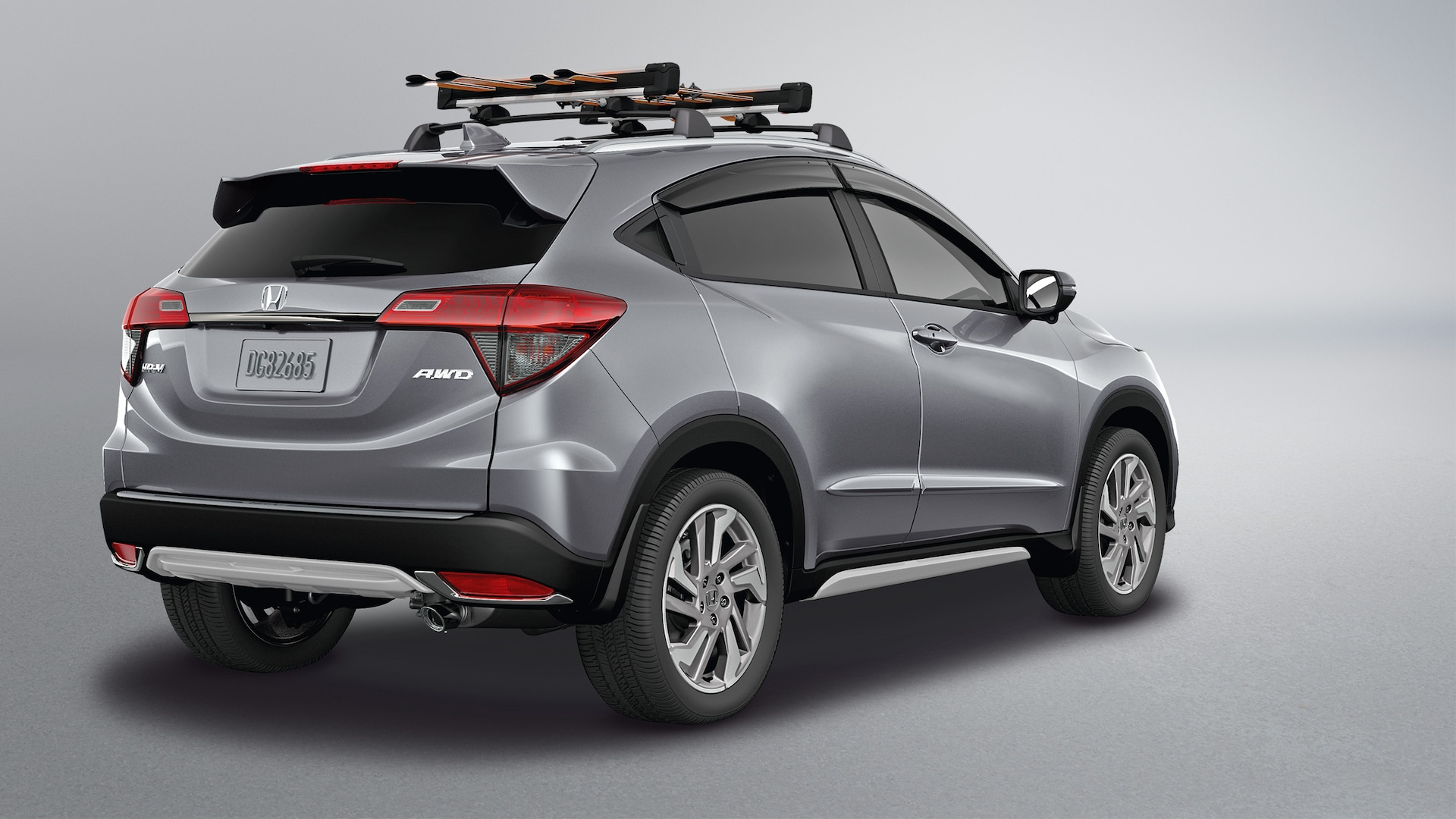 Rear passenger-side view of the 2021 Honda HR-V EX in Lunar Silver Metallic with Honda Genuine Accessories.