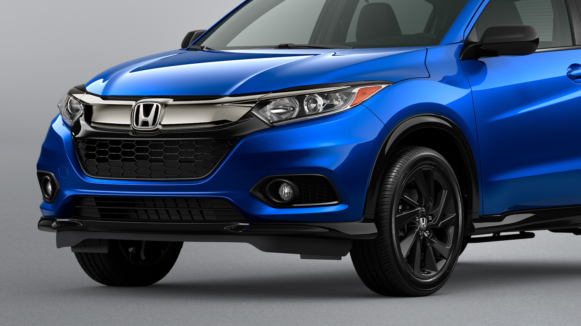 Front driver-side view of the 2021 Honda HR-V Sport in Aegean Blue Metallic.