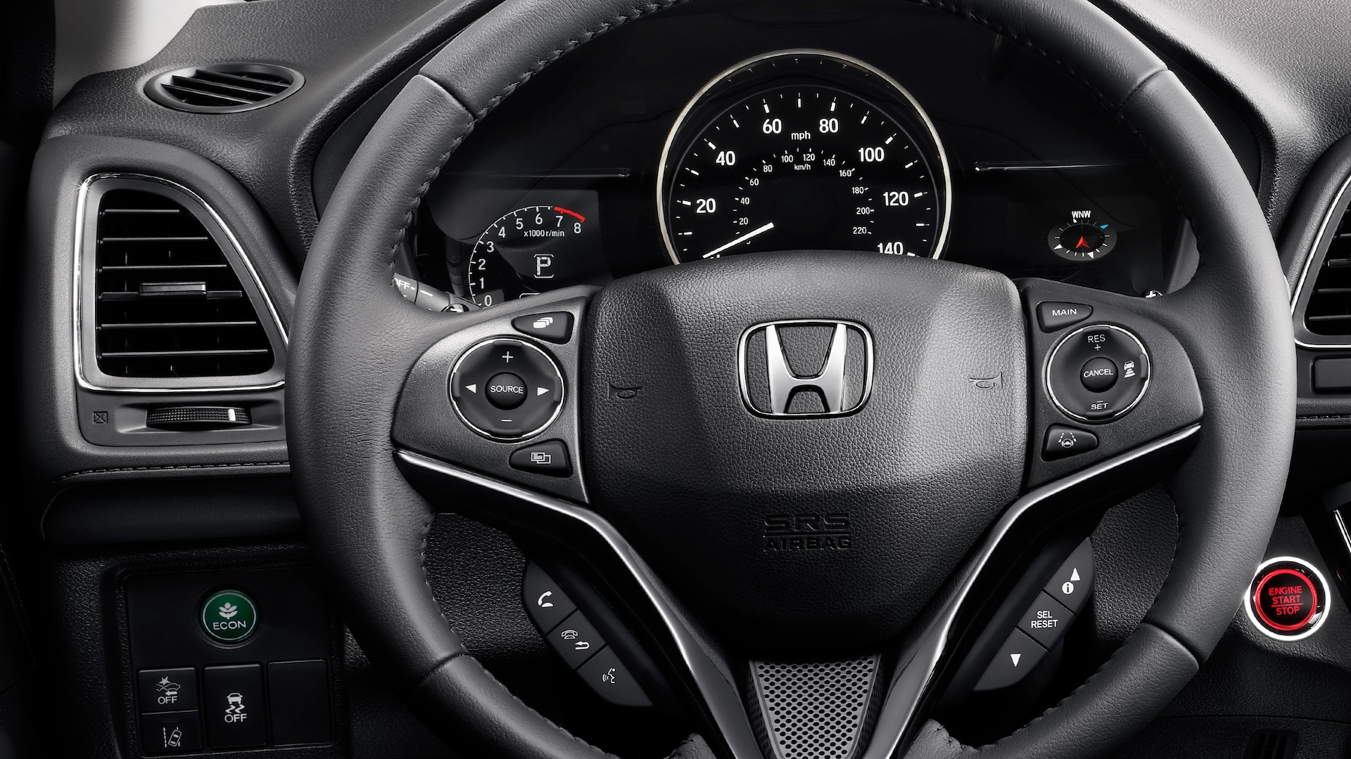 Steering wheel and dashboard detail in the 2021 Honda HR-V EX-L with Black Leather.