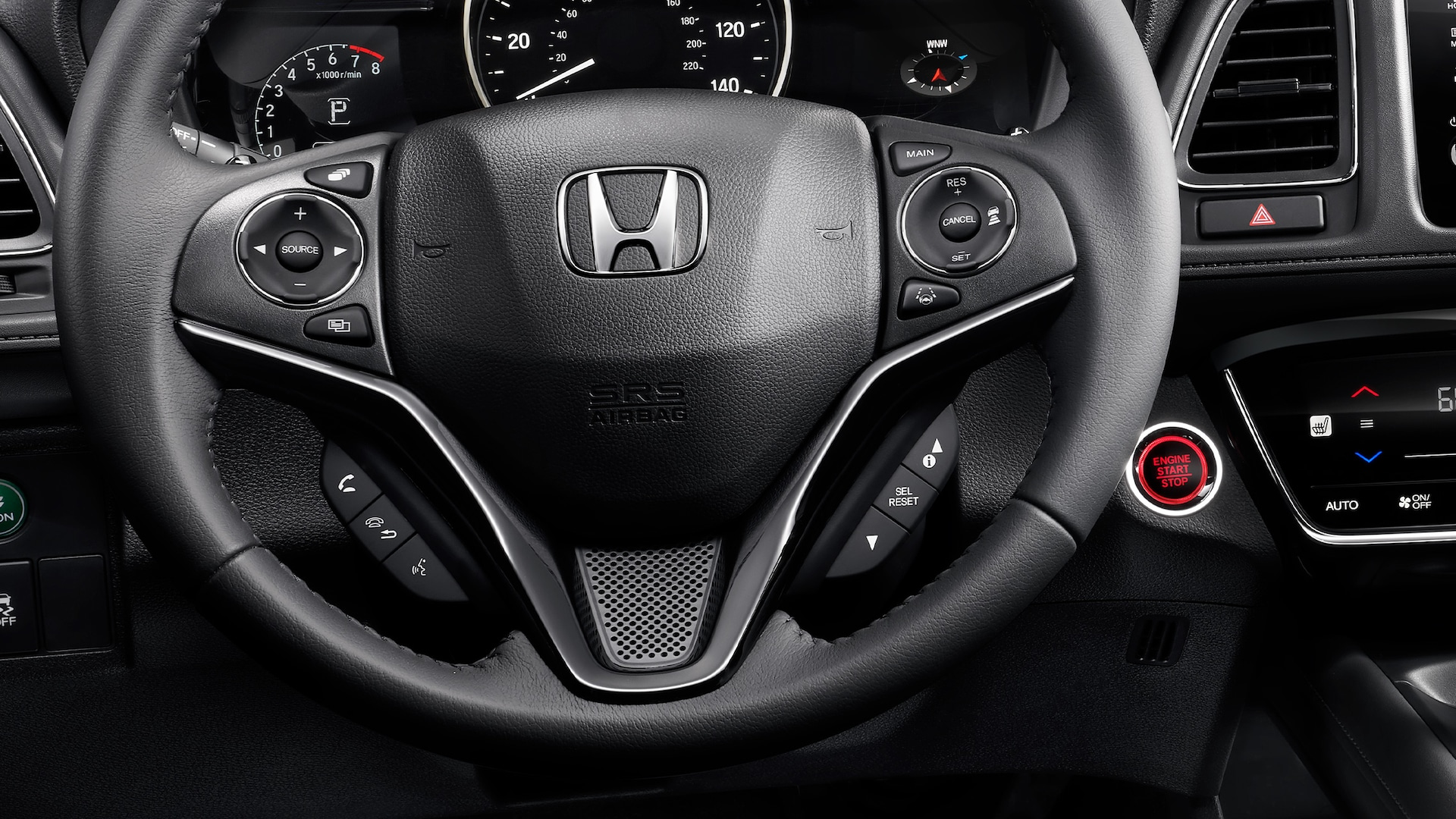 Detail view of steering wheel with Bluetooth® HandsFreeLink® in the 2021 Honda HR-V EX-L.