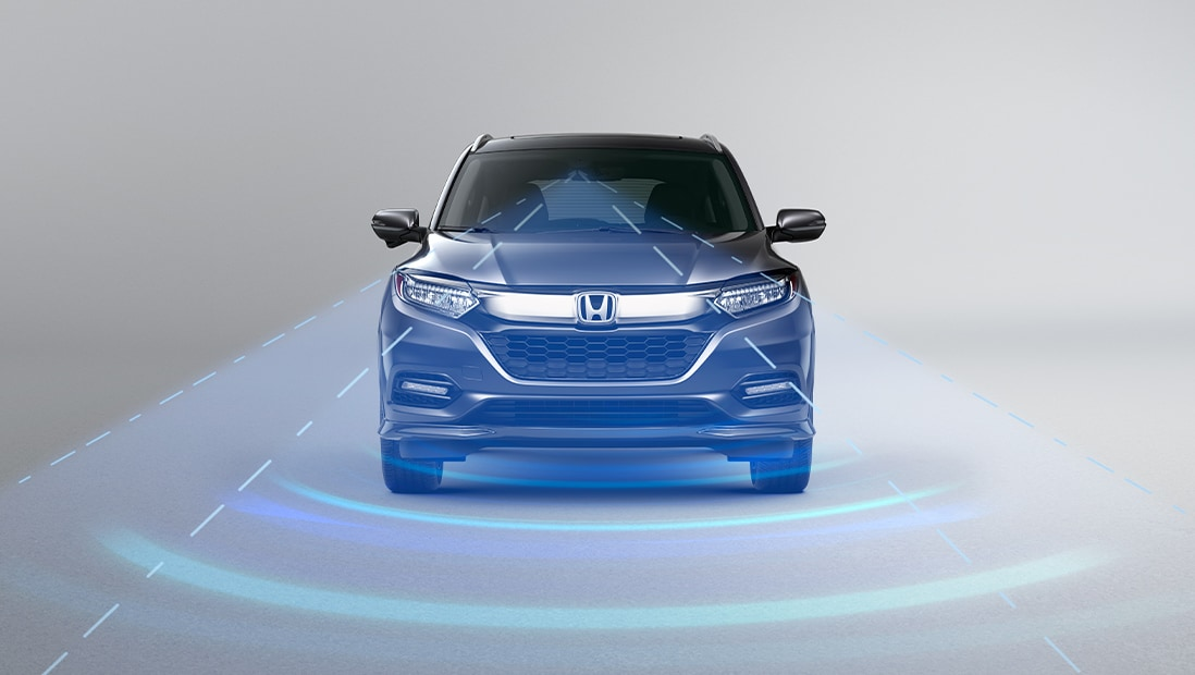 Honda Sensing® overview. Plays video. Opens a dialog.