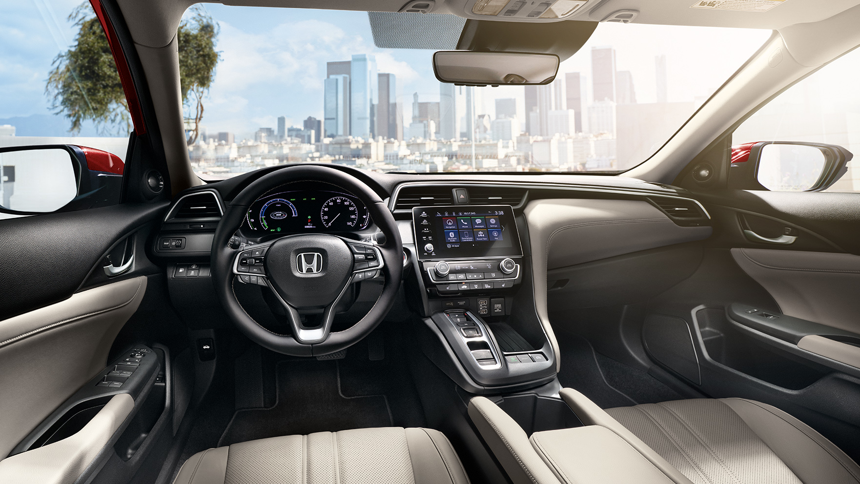 Interior view of steering wheel and dash on 2021 Honda Insight Touring with Ivory Leather.