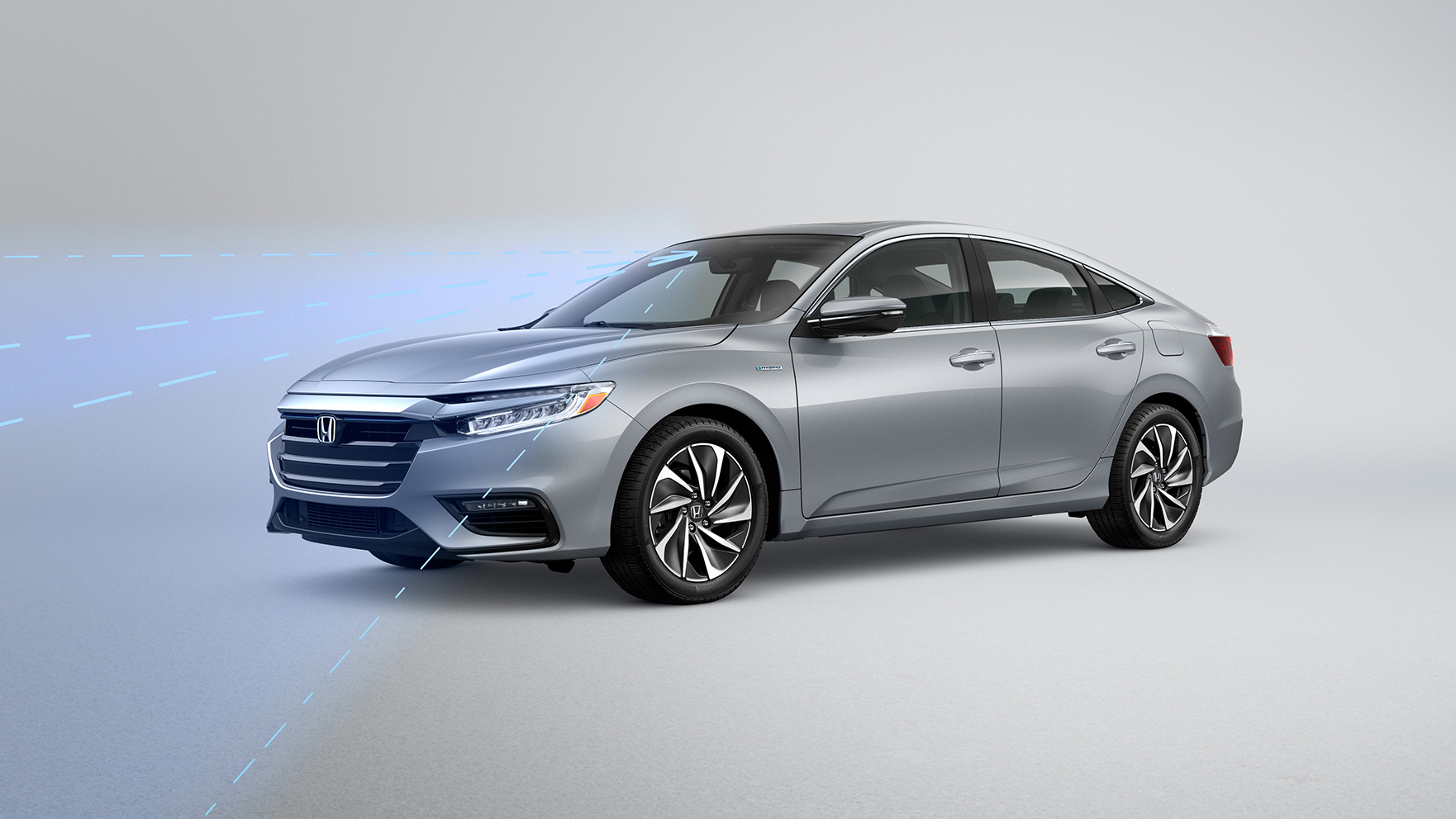 Front driver-side view of the Honda Insight Touring in Lunar Silver Metallic, with illustrated graphics demonstrating Road Departure Mitigation feature.