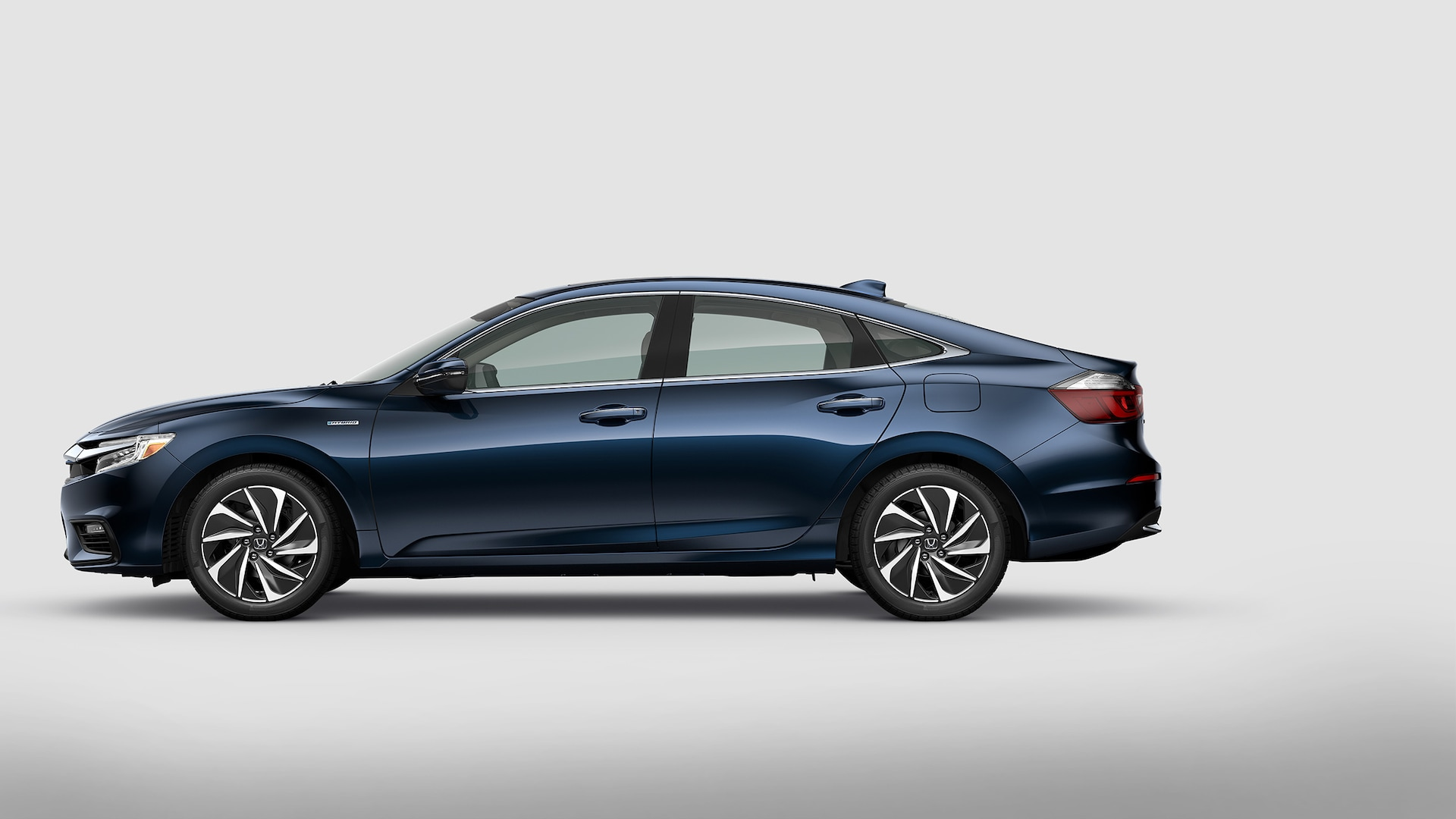 Driver-side profile view of 2021 Honda Insight Touring in Cosmic Blue Metallic.