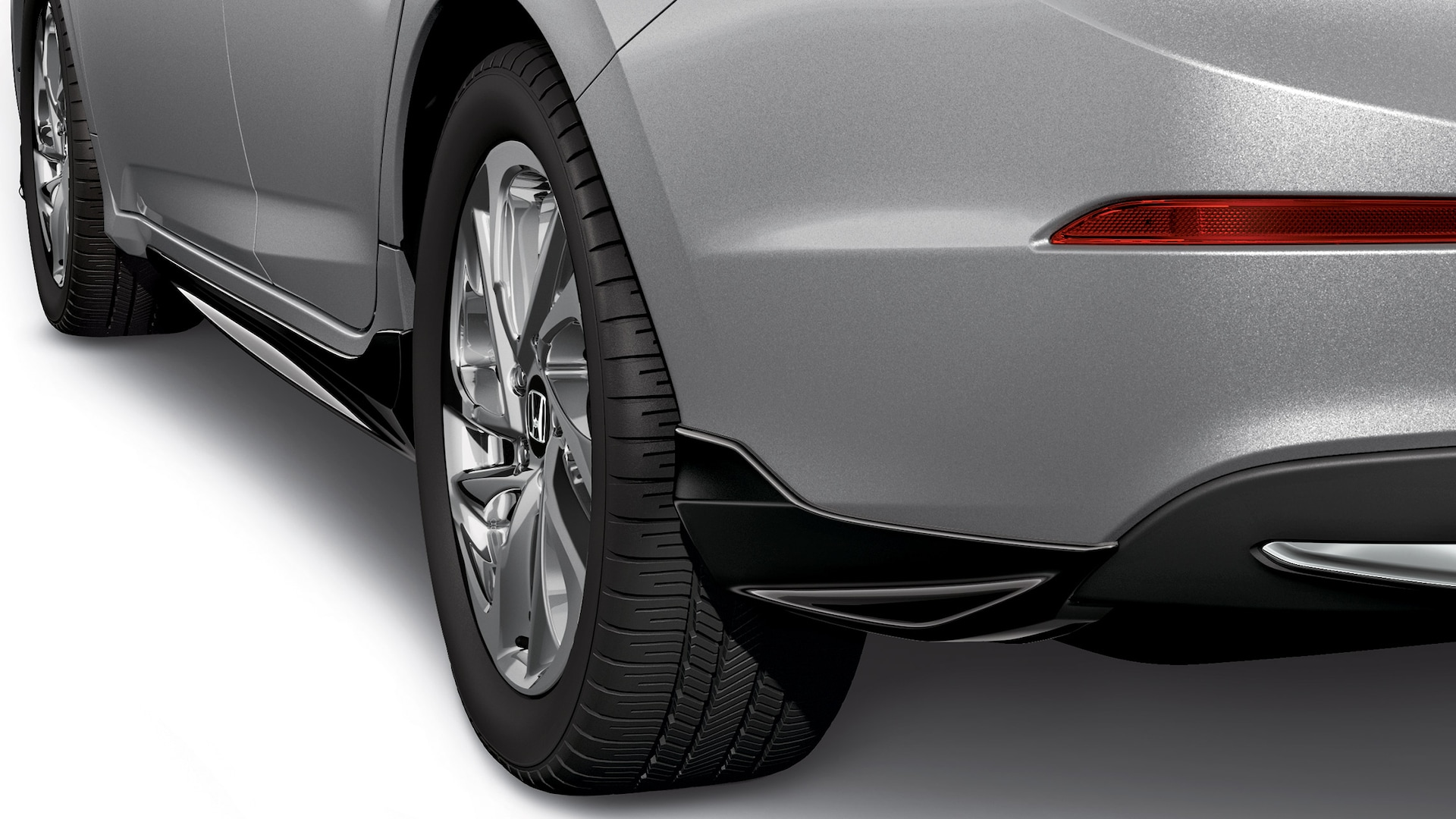 Detail of accessory rear underbody spoiler on the 2021 Honda Insight Touring in Lunar Silver Metallic.