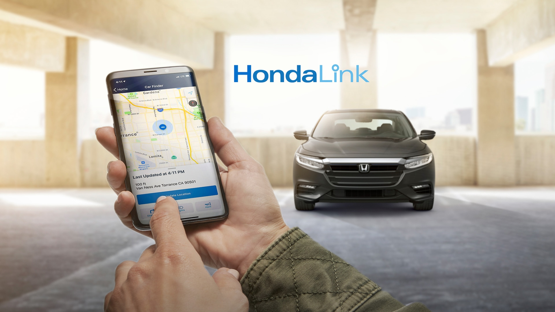 A man's hands holding a smartphone with HondaLink® screen visible, and Honda Insight parked in the background.