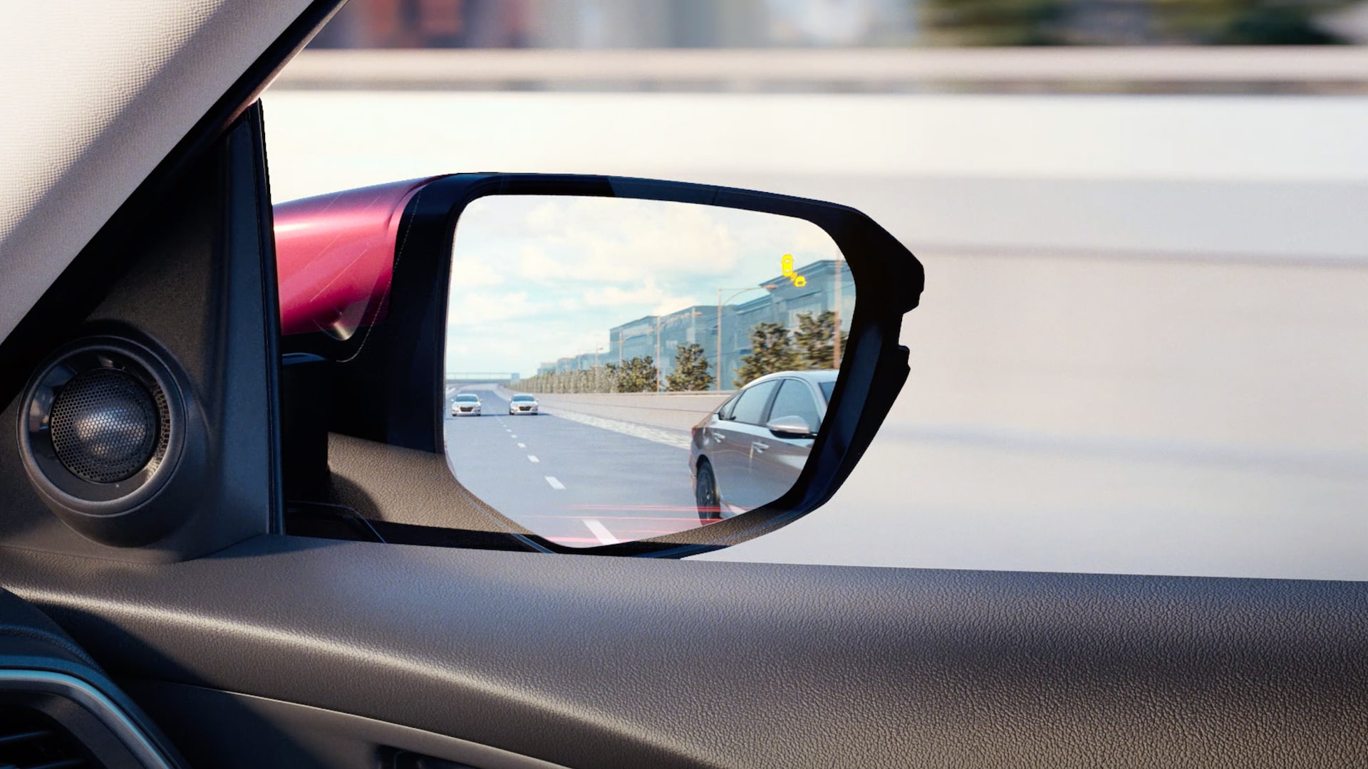 Detail of blind spot information system indicator on passenger-side mirror in the 2021 Honda Insight.