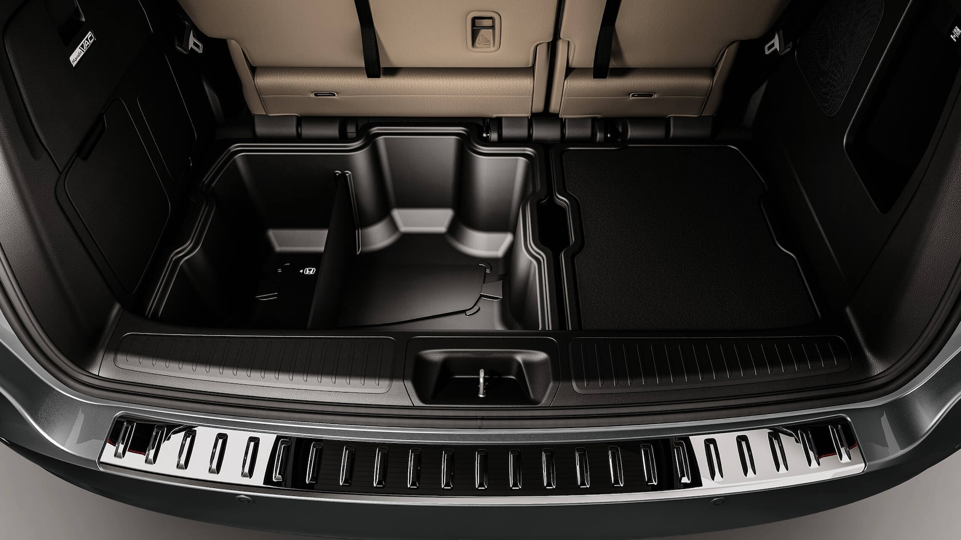 Detail of the 2022 Honda Odyssey accessory cargo bins.