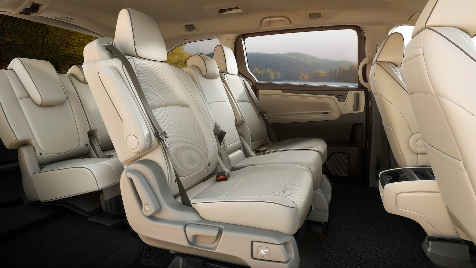 Interior passenger-side profile view of rear seats in the 2022 Honda Odyssey Elite with Beige Leather.