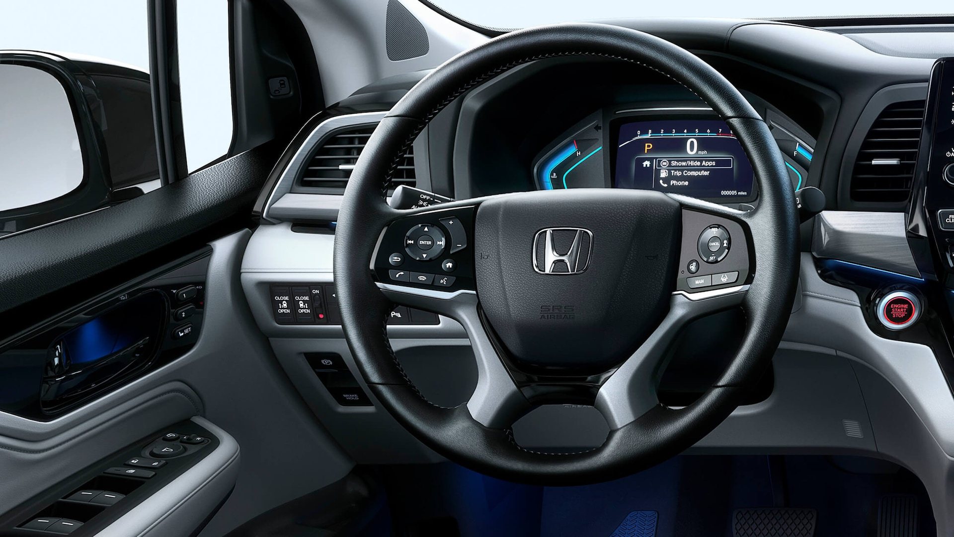 Heated, leather-wrapped steering wheel detail on the 2022 Honda Odyssey Elite.