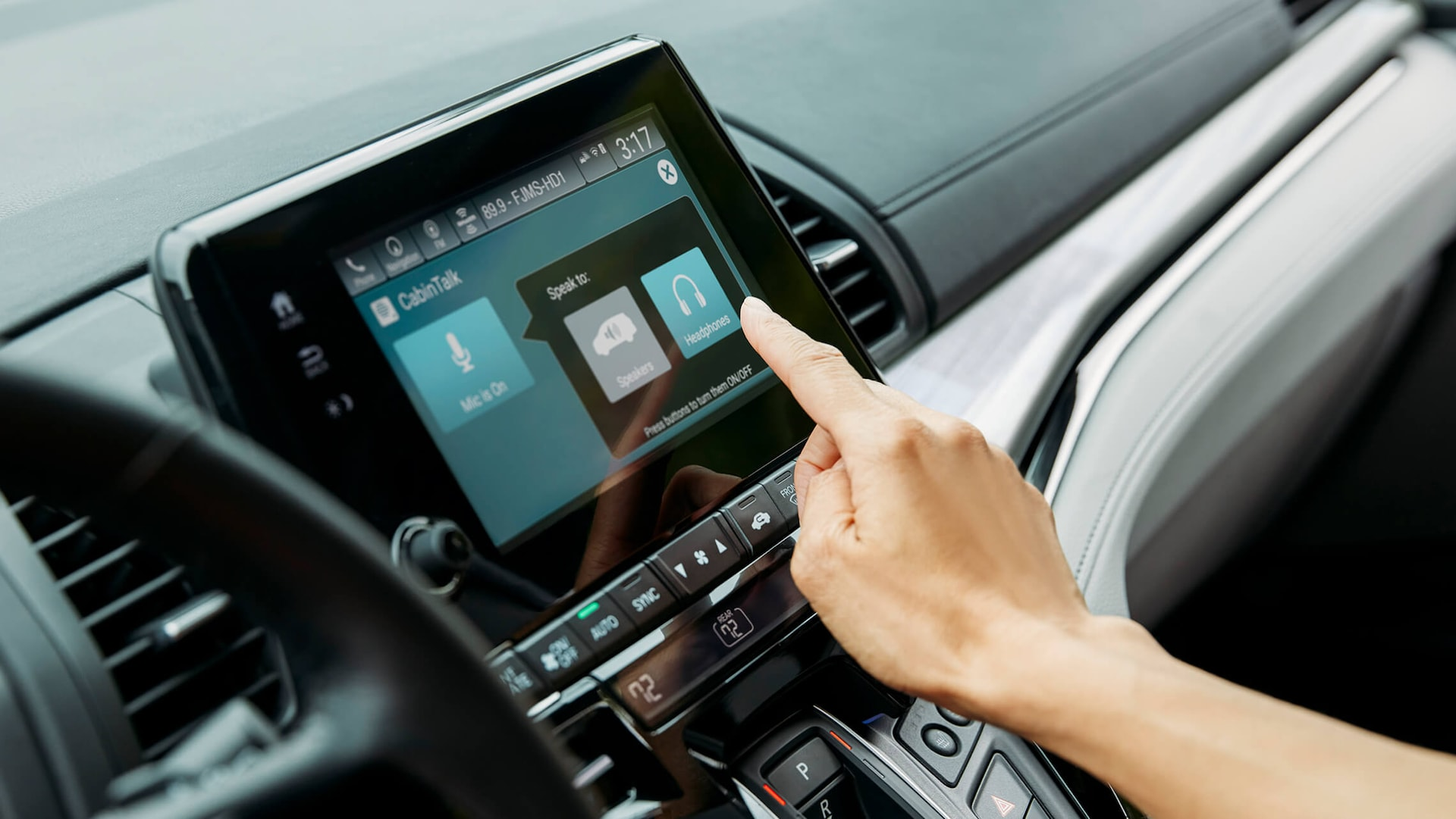 8-Inch Display Audio touch-screen detail in the 2022 Honda Odyssey Elite with Gray Leather.
