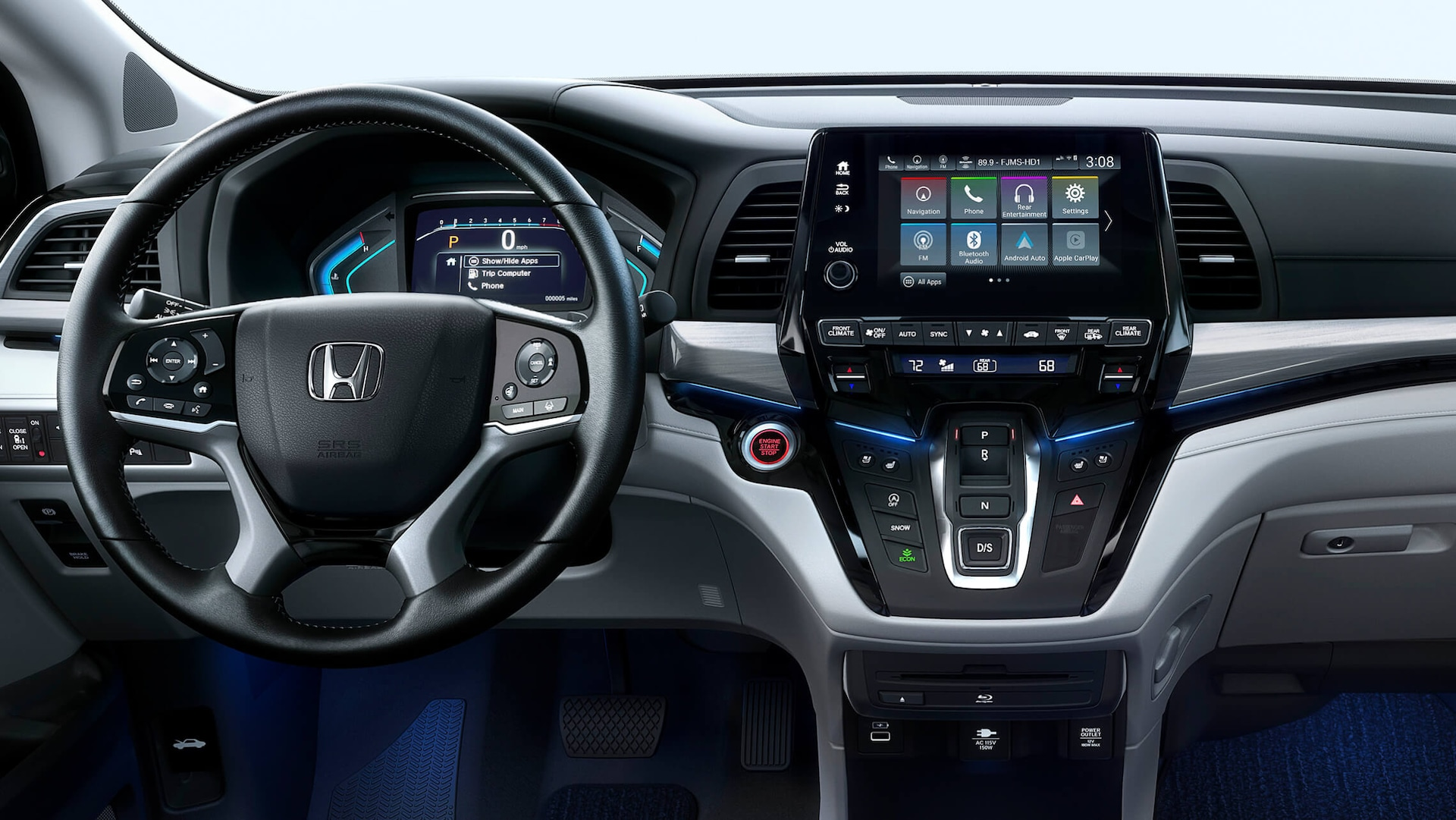Interior rear close-up view of steering wheel and dash in the 2022 Honda Odyssey Elite with Gray Leather.