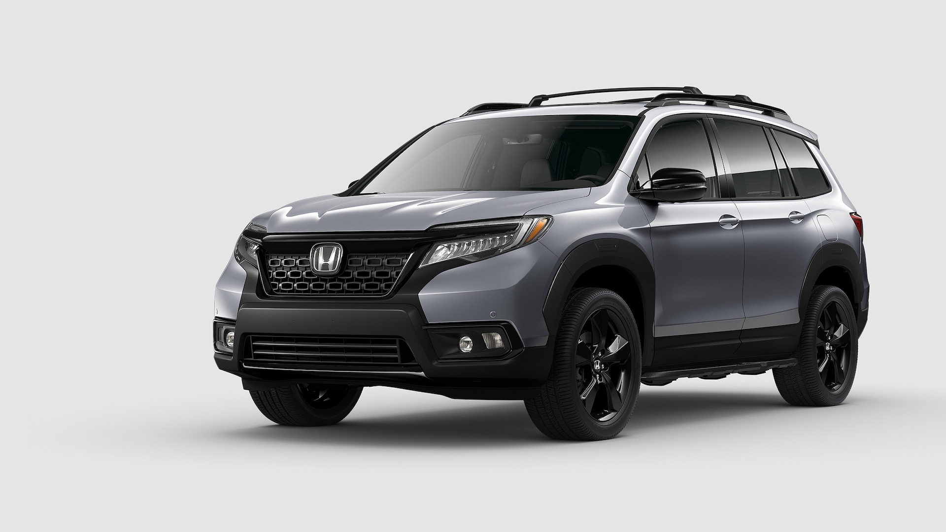 Front driver-side view of the 2021 Honda Passport Elite in Lunar Silver Metallic with Honda Genuine Accessories.