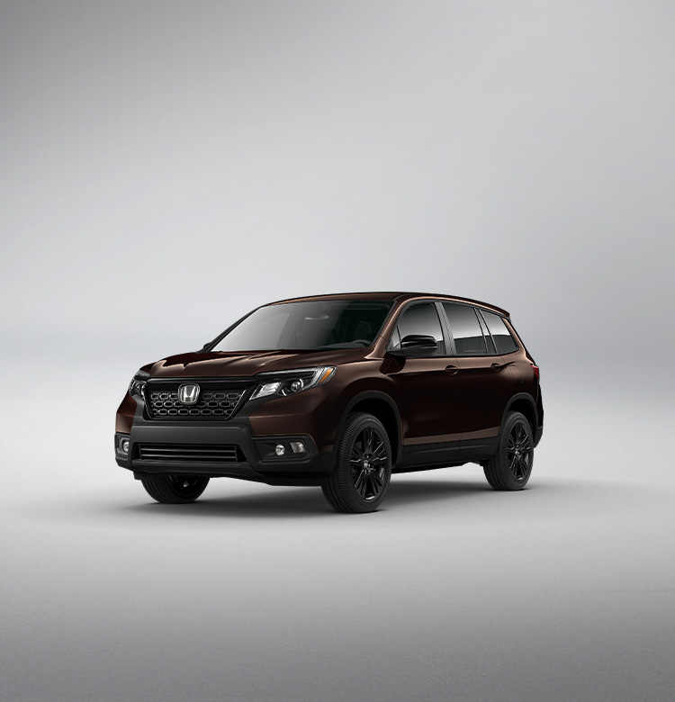 Front passenger-side view of the 2021 Honda Passport Sport in Black Copper Pearl.