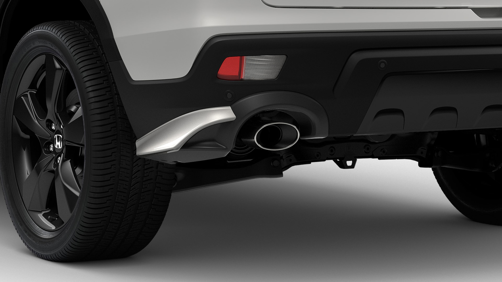 Detail of accessory rear underbody spoiler on the 2021 Honda Passport.