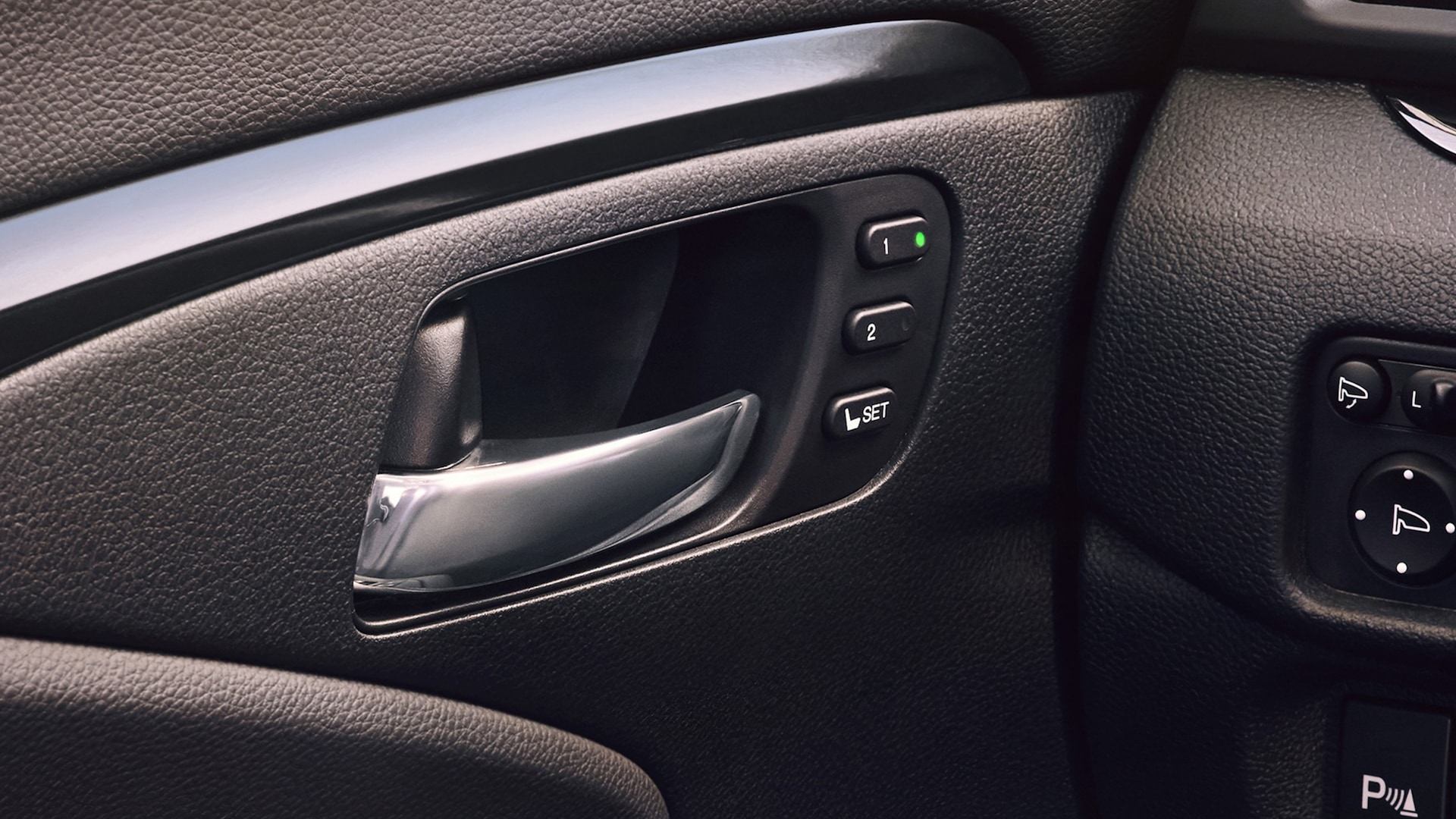 Driver's seat memory setting detail on the 2021 Honda Passport Elite with Black Leather interior.