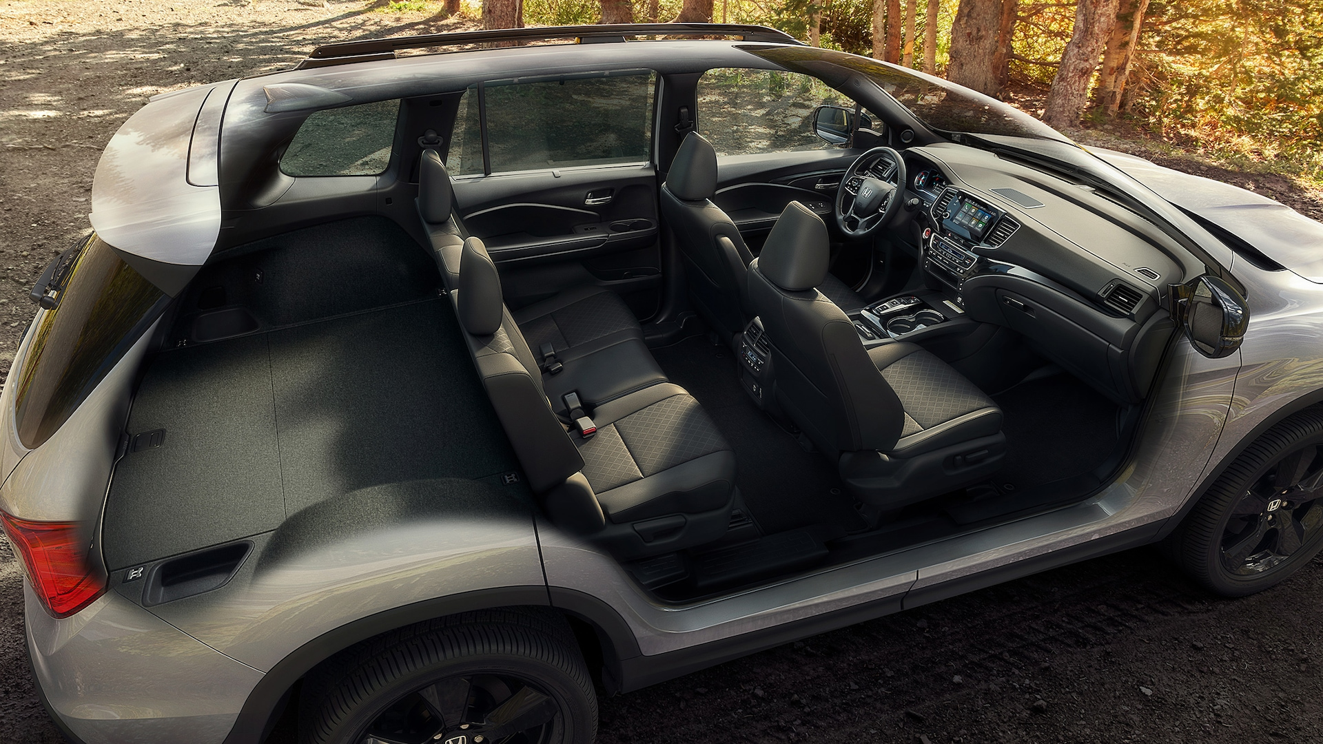Full interior shot of the 2021 Honda Passport Elite with Black Leather displaying spacious interior and cargo capacity.