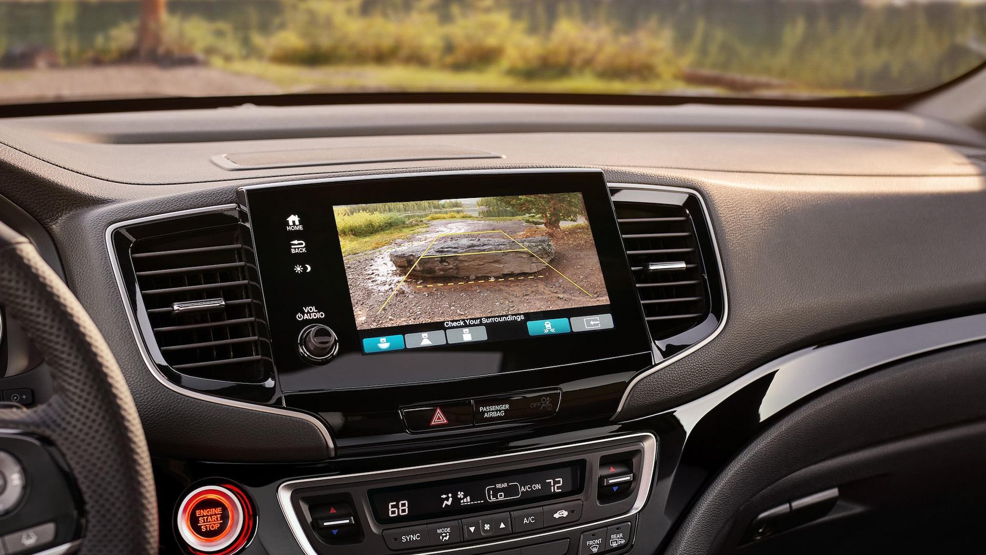 Interior view of the 2021 Honda Passport Elite showing the multi-angle rearview camera on the Display Audio touch-screen.