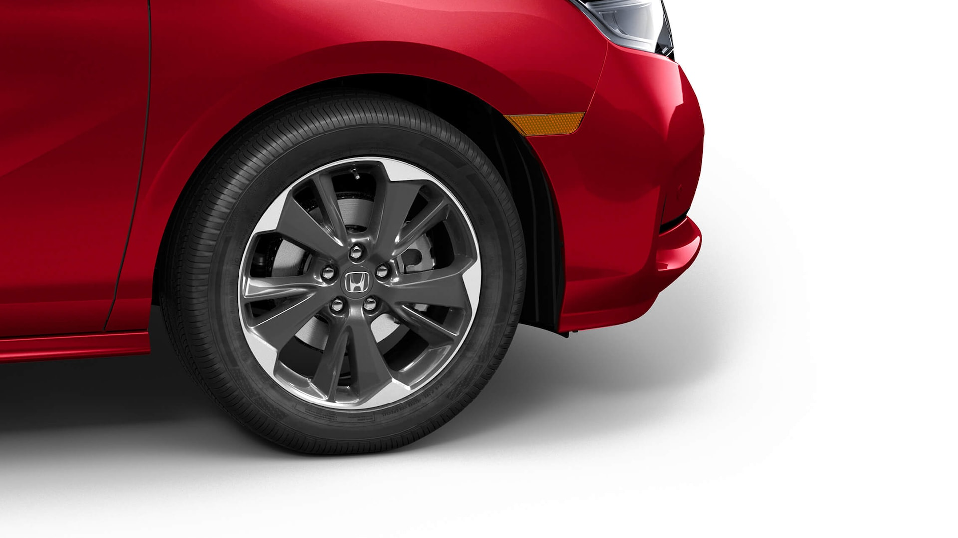 19-inch alloy wheel detail on the 2022 Honda Odyssey Elite in Radiant Red Metallic II.