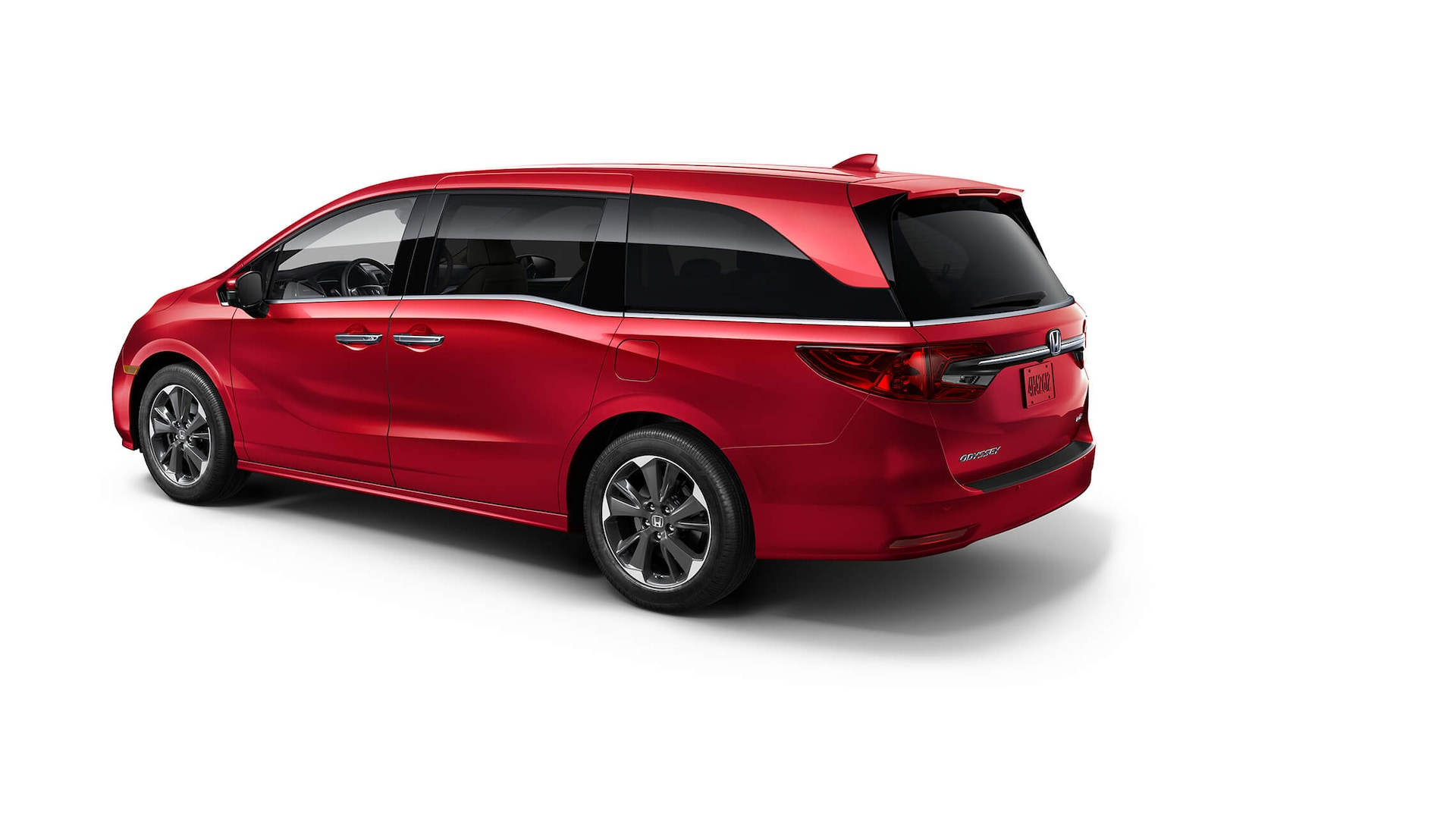 Rear driver-side view of the 2022 Honda Odyssey Elite in Radiant Red Metallic II.