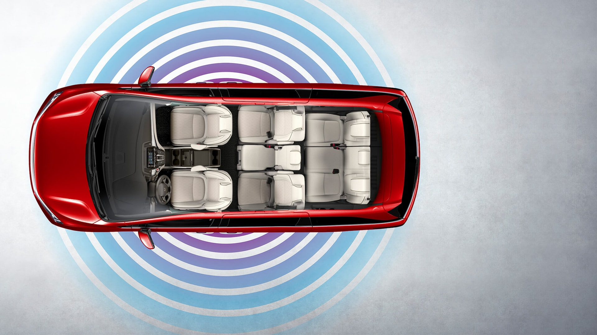 Overhead view of the 2022 Honda Odyssey Elite in Radiant Red Metallic II with Wi-Fi® hotspot graphic overlay.