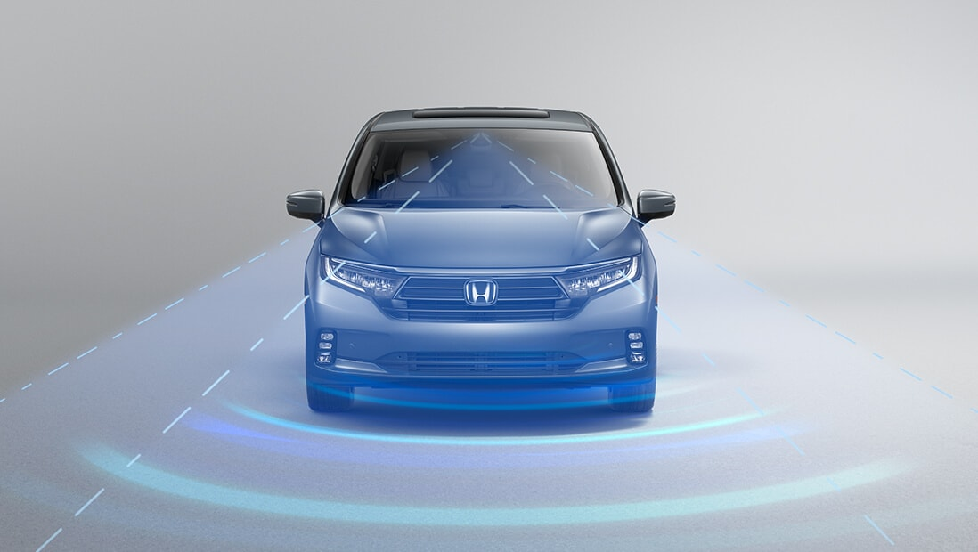 Front view of the 2022 Honda Odyssey Elite in Modern Steel Metallic, demonstrating Adaptive Cruise Control with Low-Speed Follow feature.