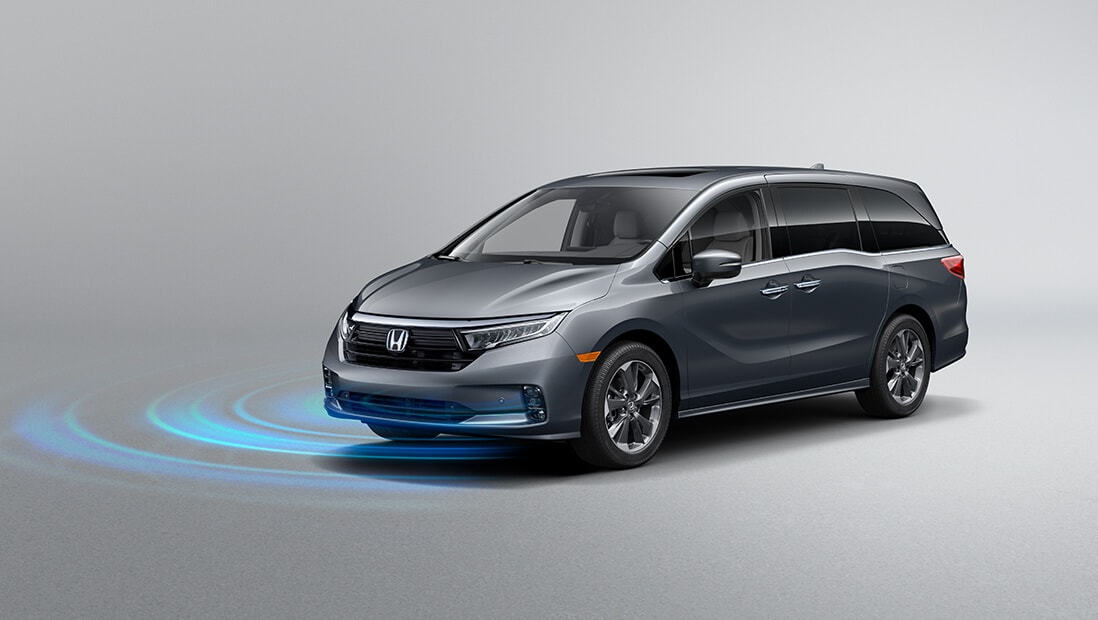 Front driver-side view of the 2022 Honda Odyssey Elite in Modern Steel Metallic, demonstrating Road Departure Mitigation System feature.
